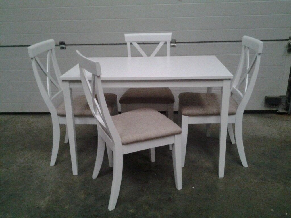New Bargain. White table and 4 chairs. Boxed. Can deliver.