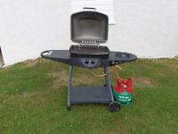 Gas Barbecue with full gas cylinder and regulator.