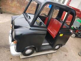 London black cabcoin operated kids ride