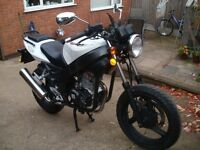 WHITE KNUCKLE 125 R .. ONLY 6 MONTHS OLD