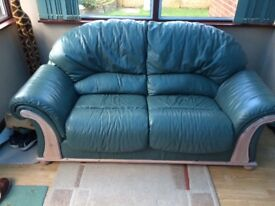 2 seater leather sofa,very good condition,pale green colour