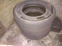 Two remoulded car tyres 155 R 13