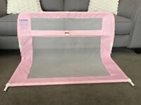 Pink Lindam bed guard, small tear (shown in photo) used condition, smoke free home.