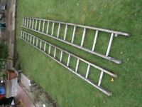 Extension Ladders wooden with metal rungs.