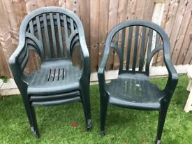 4 Green plastic garden chairs