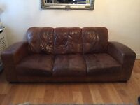 Brown leather three-seater sofa. Warn withou any rips. Very comforatable in a smoke free home