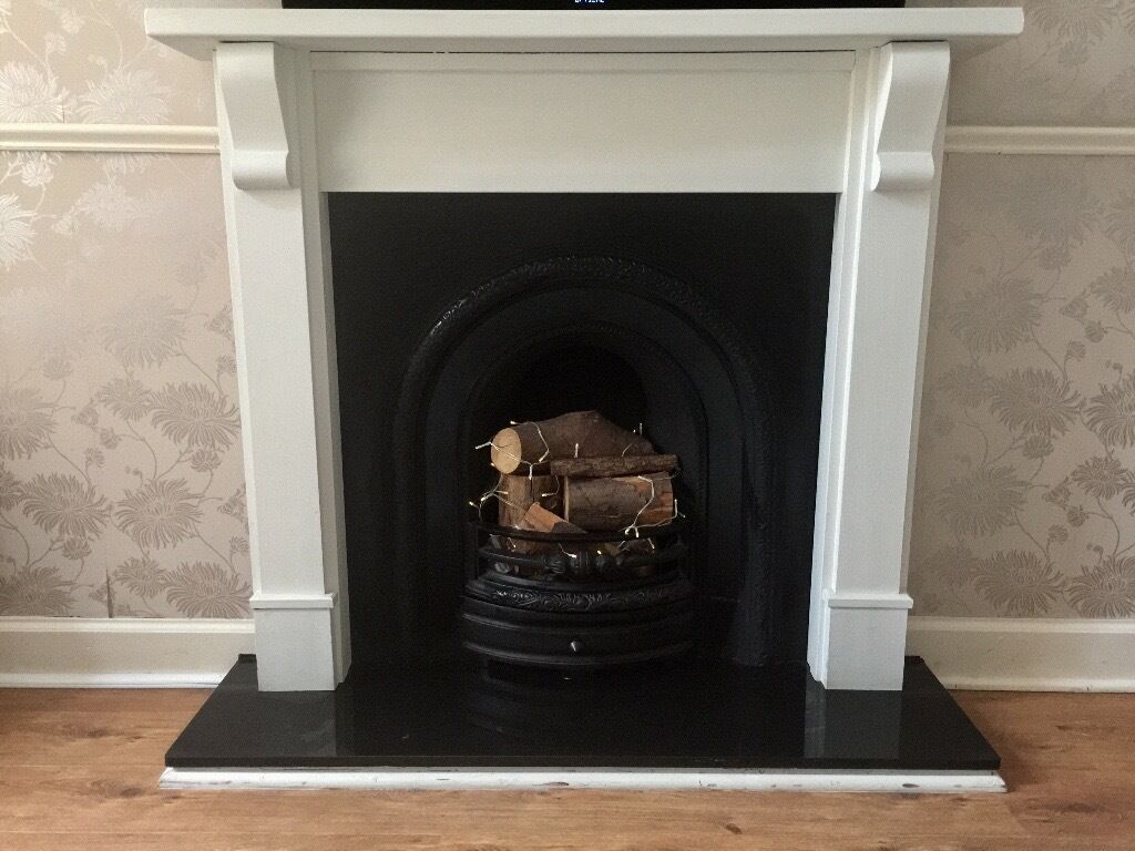 Cast iron fireplace with painted white solid wood surround ...