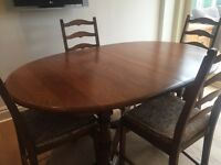 Genuine Ercol extending dining table and four chairs