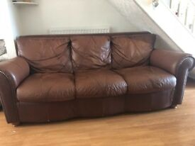 Leather brown 3 seater sofa slight unstitched area