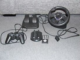 PLAY STATION 2 - MEGA PACK- STEERING WHEEL, DUAL SHOCK CONTROLLER, VERTICAL STAND DVD REMOTE CONTROL