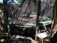 12ft trampoline used. With mesh and ladder.