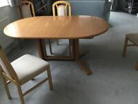 Reduced Price !! Extending light oak table with 4 free chairs!!