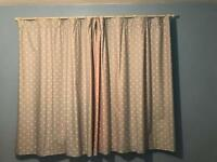 Polka dot curtains and cream curtain pole