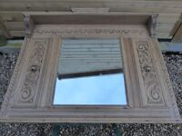 Victorian stripped carved oak overmantel with bevelled edge mirror.