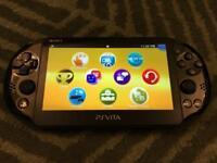 PS VITA Slim and 6 Games