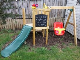 Nearly new! Beautiful outdoor wooden fortress tower,swing, slide, platform,steering wheel &telescope