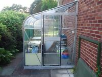 Lean to greenhouse with door. Buyer will need to dismantle and transport.