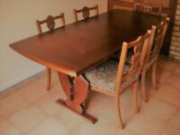 Solid mahogany dining table and 5 Edwardian upholstered chairs
