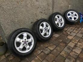 "Saab genuine 16"" alloys w/Michelin Continental tyres"