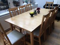 Set of dining table and 8 chairs in light oak and option to buy same style armchair