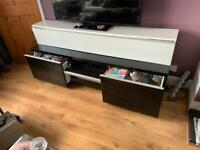 White high gloss tv unit. Can be mounted on wall