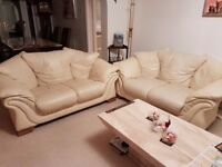 2 x Two-seater Cream Leather sofas or sell separately