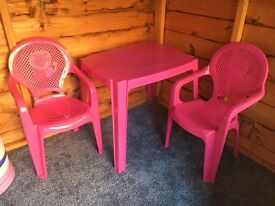 Pink plastic table and two chairs