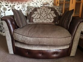 Two seater swivel chair.