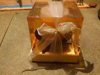 Brand New, unopened, boxed heavy Candle with elegant holder, beautifully wrapped with bow!