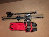 Salomon Powerline 137 cm race skis with poles and shin guards