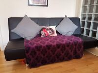 Black leather sofa bed for sale (collection only)