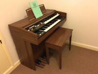 Electric organ for sale in good working order. Comes with a few music books.