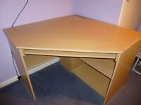 Corner desk with pull-out computer shelf and shelving