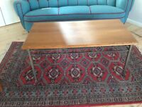 Natural wood and metal coffee table