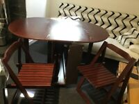 DOUBLE LEAF FOLDING TABLE WITH SLOT FOR FOLDING CHAIRS