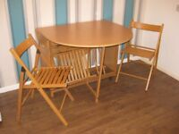 Oval Dining Table and 4 Folding Chair Set.