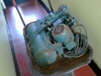 vintage old heavy portable air compressor