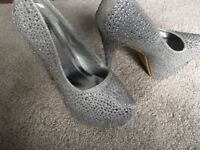 Size 6 Silver heels never been worn