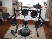 Electronic drum kit - Alesis DM5, drum sticks & teaching manual