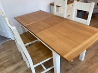 Cream extending dining table and chairs