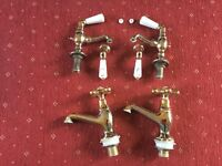Gold coloured bath and basin taps - used