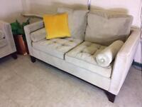 Made com Scott style two seater sofa in pale green velvet