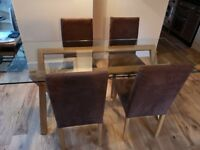 Habitat glass table on wooden trestle and fours chairs Table is L180 xW80 x H70