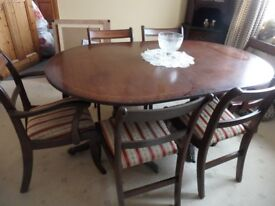 Dining Table with extra leaf and 6 chairs