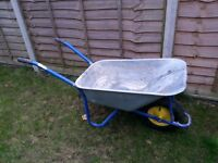 Metal wheelbarrow.