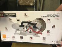 Compact slide compound mitre saw