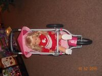Rosie doll and push chair