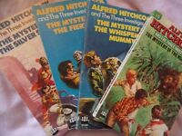 Set of four vintage paperback Alfred Hitchcock books, printed in the 1960s and 1970.