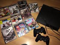 Ps3 with 2 controllers and games..