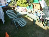2x2 seater, 1x recliner green garden chairs.